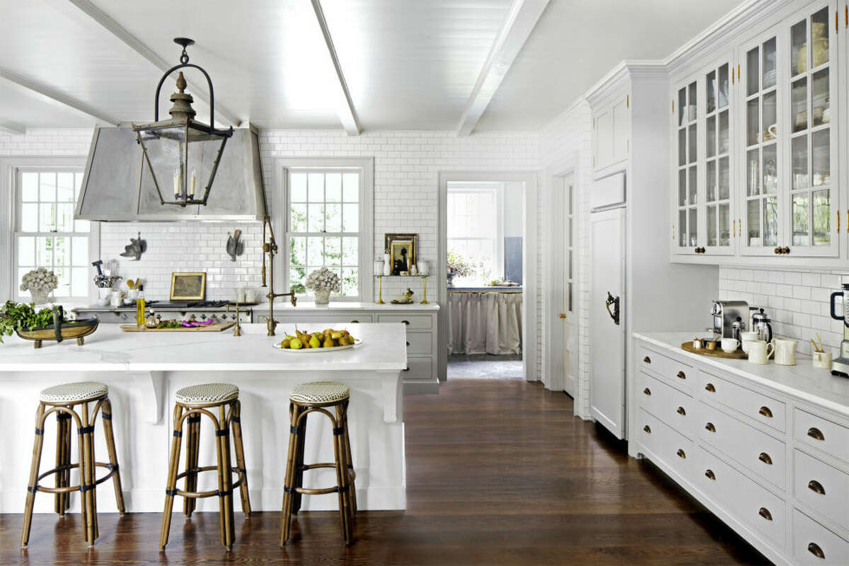 """1) Darker Floors If you choose a light paint for walls or cabinetry, select a dark floor stain to up the cozy factor of the room. Mixone-half Ebony and one-half Jacobean from Minwax. Bonus idea: The addition of furniture-like """"feet"""" gives cabinetry a softer, more custom feel."""