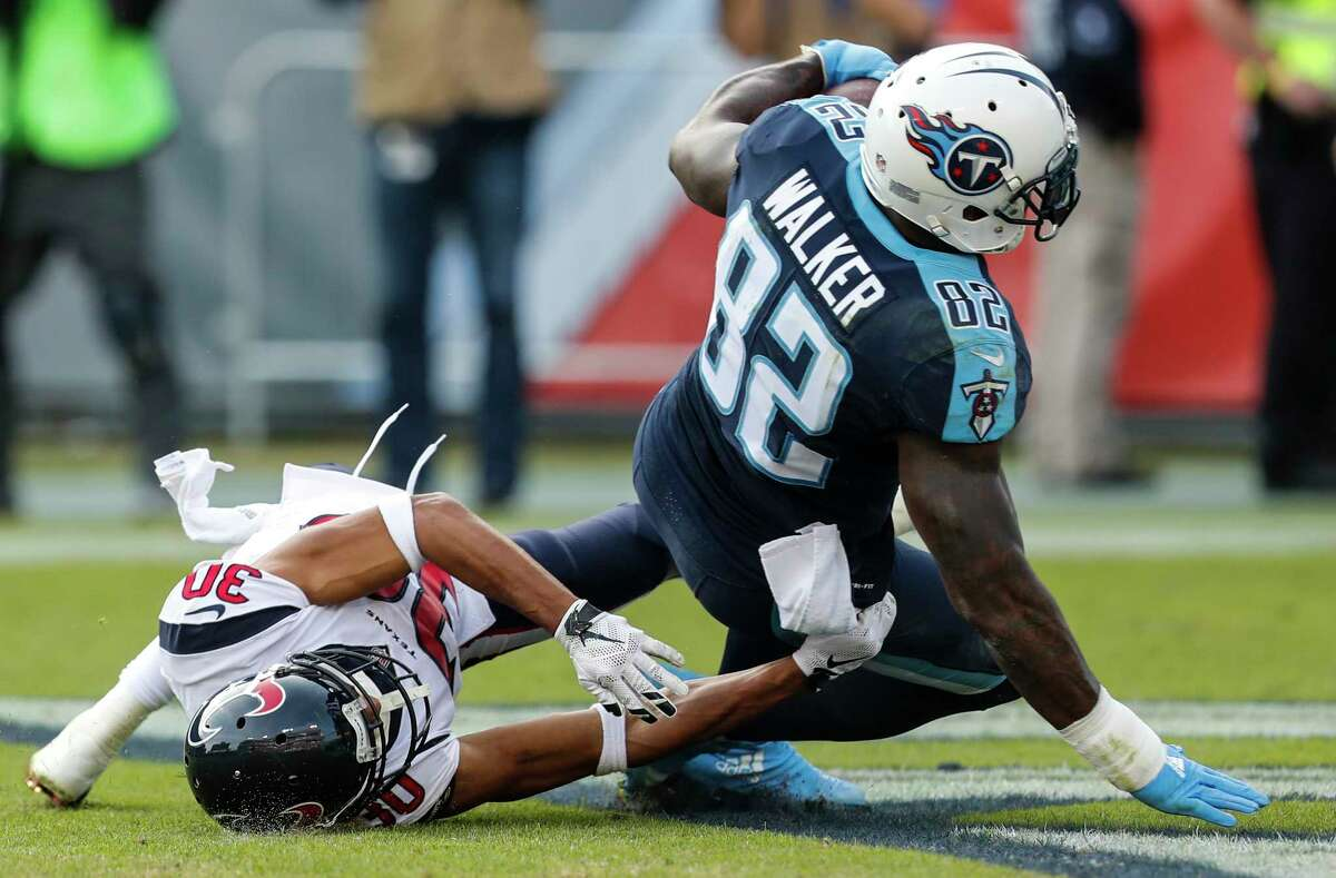 The Texans had their chances in recent losses to the Titans and Ravens, but were on the wrong end of too many plays, like Kevin Johnson, left, getting beat by Tennessee receiver Delanie Walker for a touchdown.