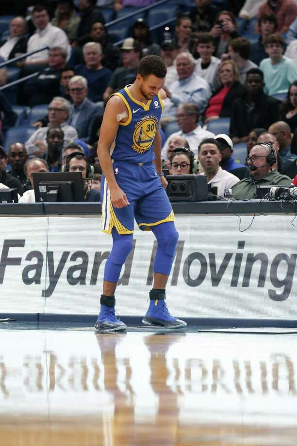 Warriors guard Stephen Curry is expected to miss at least two weeks after spraining his ankle late in Monday's game against the Pelicans. Photo: Gerald Herbert / Gerald Herbert / Associated Press / Copyright 2017 The Associated Press. All rights reserved.
