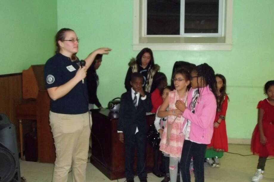 Vista volunteer and program coordinator Cassidy Layman leads  RISSE class in singing. (Submitted photo)