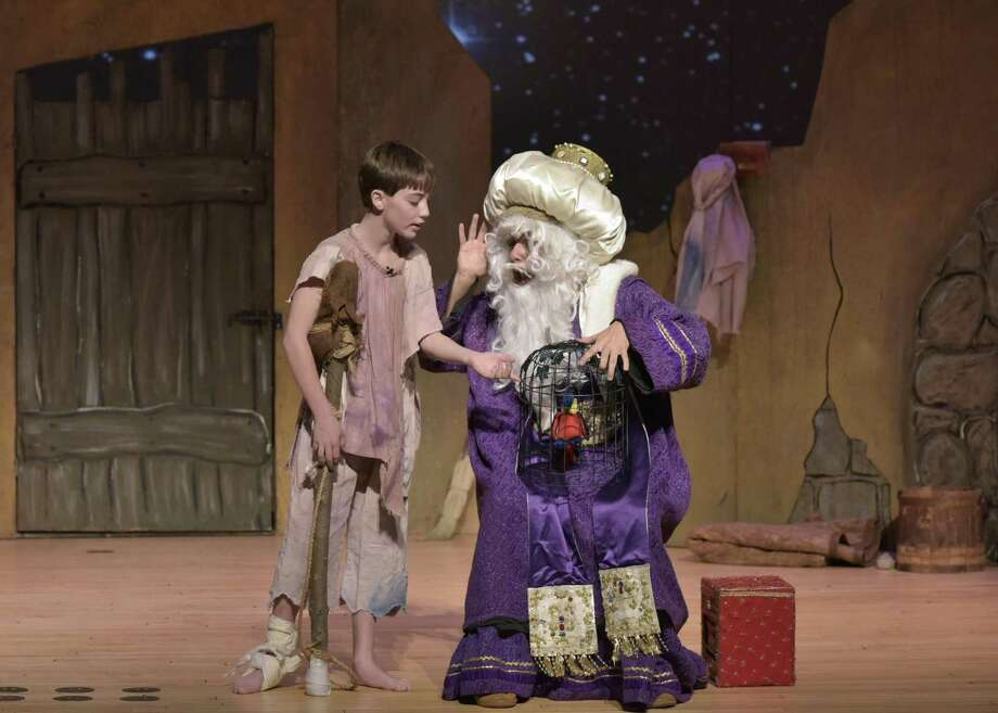 "Amahl (left), performed by Mason Harper, of Woodbury, speaks with King Kaspar, played by Edwin Rodriguez, of West Haven, during a scene from the WCSU production of Gian Carlo Menotti's ""Amahl and the Night Visitors."" Photo: Photo By Peggy Stewart / WCSU"