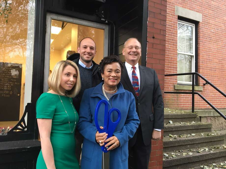From left, Andrea DiLieto Zola and Mayor Toni Harp outside BarBeauty, Zola's business on Wooster Street in New Haven. Behind them are Alder Aaron Greenberg and Economic Development Administrator Matthew Nemerson. Photo: Mary E. O'Leary / Hearst Connecticut Media