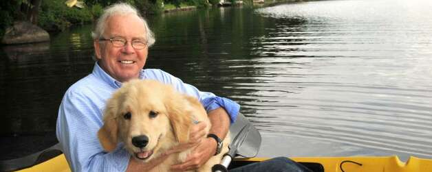 "Retired professor Tom Glynn, 60, with Dude, his 4 month old puppy, in a kayak on Lake Kenosia in Danbury says "" I think America mostly means freedom. I've lived in other countries where there's not much freedom and I know most of us take our freedom for granted. Motherhood, apple pie and freedom."""