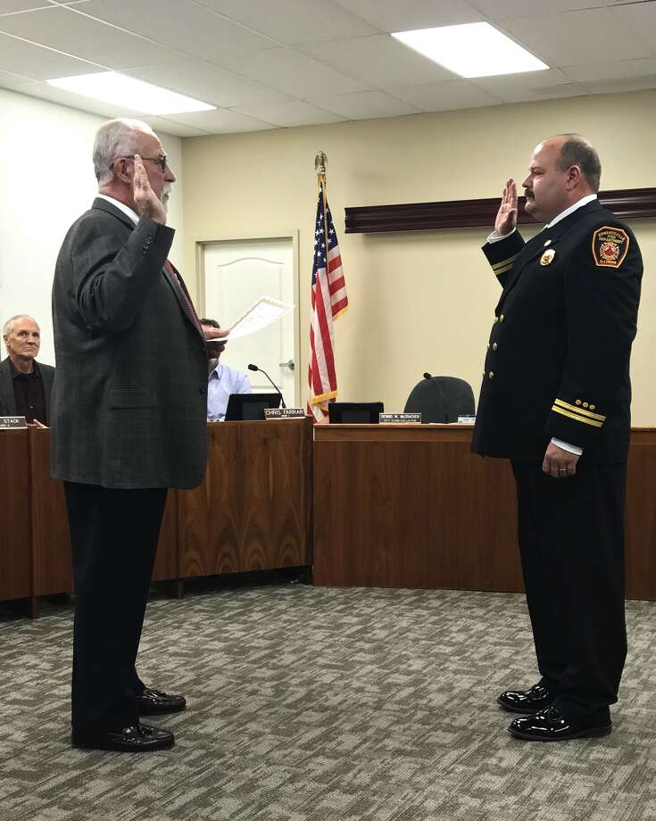 Captain James Whiteford, of the Edwardsville Fire Department, was sworn in by City Clerk Dennis McCracken (left) as a new deputy fire chief for the city of Edwardsville at Tuesday's meeting. Photo: Cody King • Cking@edwpub.net