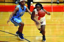 EHS point guard Quierra Love, right, dribbles the ball during the third quarter.