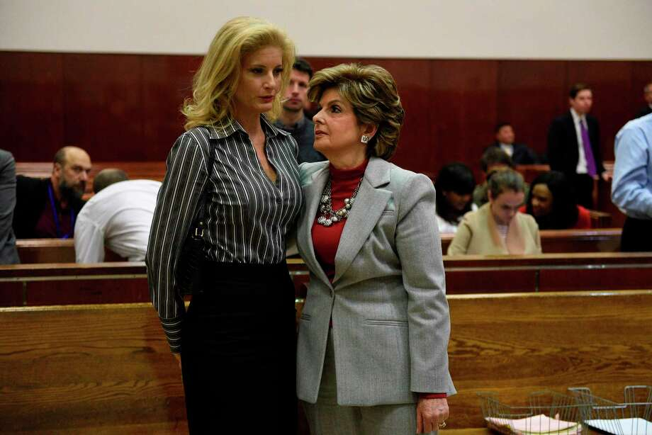 "Summer Zervos (L), a former contestant on the television show ""The Apprentice,"" listens to her lawyer Gloria Allred in New York County Criminal Court on December 5, 2017, in New York, during a hearing on the defamation lawsuit againt US President Donald Trump.   Zervos is accusing Trump of sexually harassing her during her stint as a contestant on the show which Trump hosted in 2007.  / AFP PHOTO / POOL / Barry WILLIAMSBARRY WILLIAMS/AFP/Getty Images Photo: BARRY WILLIAMS / AFP or licensors"