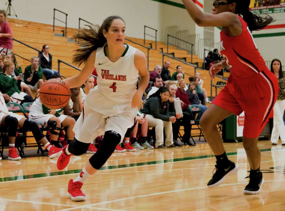 The Woodlands guard Tori Vezza drives toward the basket during a non-district game against Clear Brook on Tuesday. Photo: Keith MacPherson