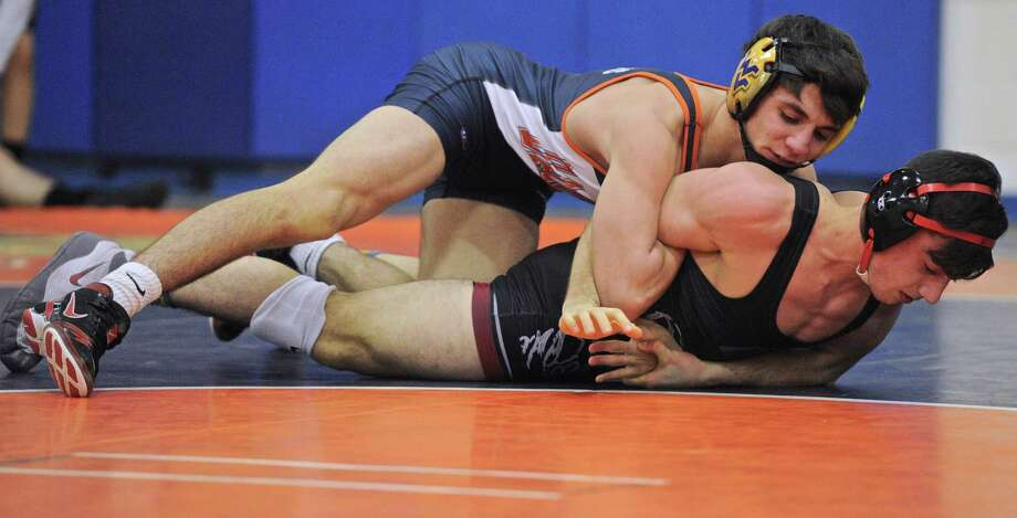 Andrew Ward's Anthony Zarlenga and Danbury's A.J. Kovacs wrestle in the 145 pound class in the high school wrestling meet between Fairfield Ward and Danbury high schools, on Wednesday, January 25, 2017, at Danbury High School, in Danbury, Conn. Photo: H John Voorhees III / Hearst Connecticut Media / The News-Times