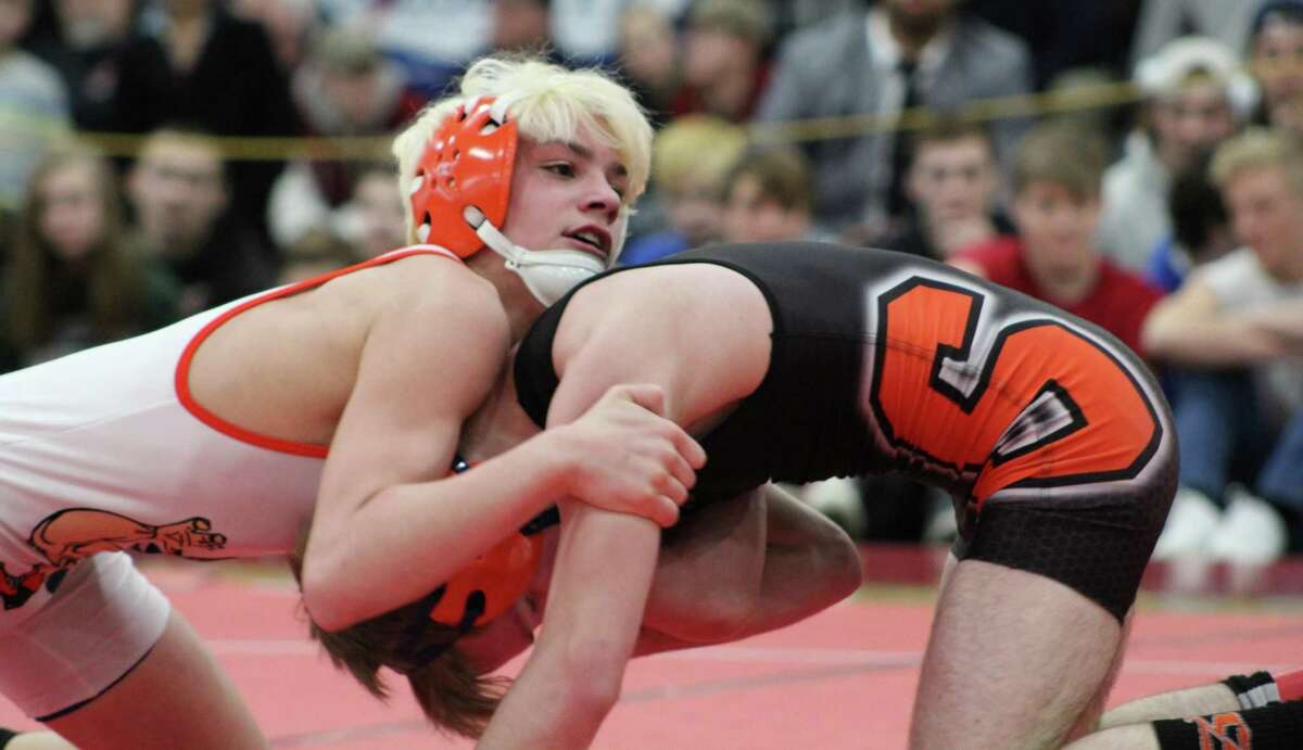Danbury's Ryan Jack, top, wrestles Cody Craig of Skowhegan in the 106-pound championship match at the New England wrestling championships in Providence March 4, 2016.