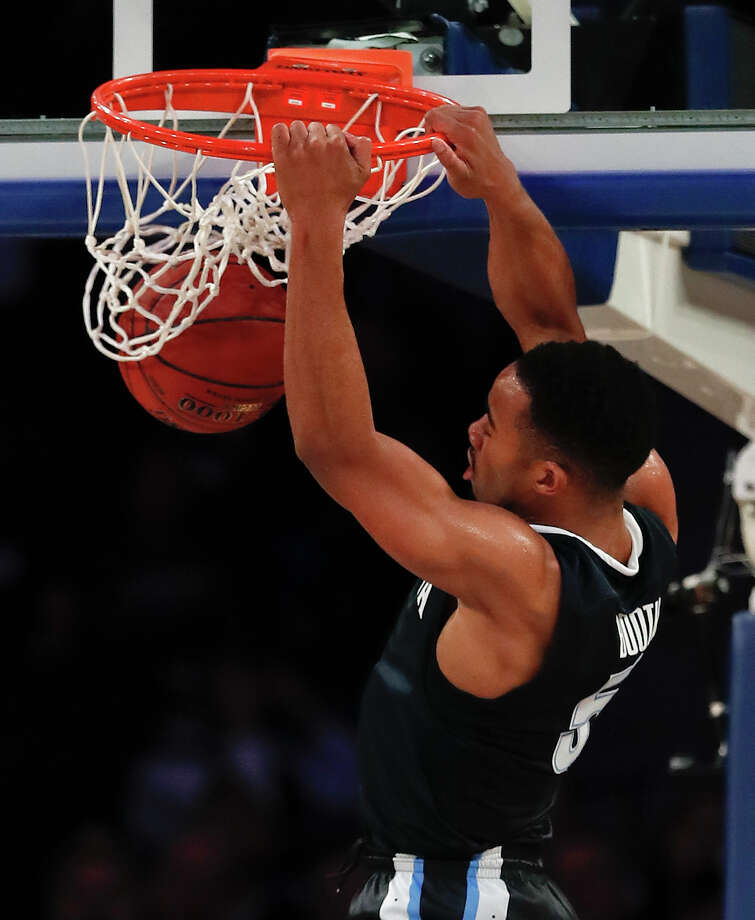 Villanova guard Phil Booth (5) dunks the ball against Gonzaga during the first half of an NCAA college basketball game, Tuesday, Dec. 5, 2017, in New York. (AP Photo/Julie Jacobson) Photo: Julie Jacobson, STF / Copyright 2017 The Associated Press. All rights reserved.