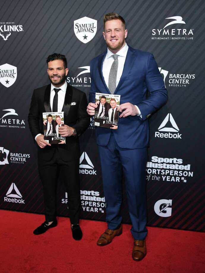 Jose Altuve, left, and J.J. Watt show off the Sports Illustrated cover on Tuesday night. Photo: ANGELA WEISS, Contributor / AFP or licensors