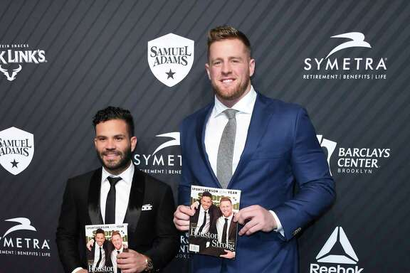 Jose Altuve, left, and J.J. Watt show off the Sports Illustrated cover on Tuesday night.