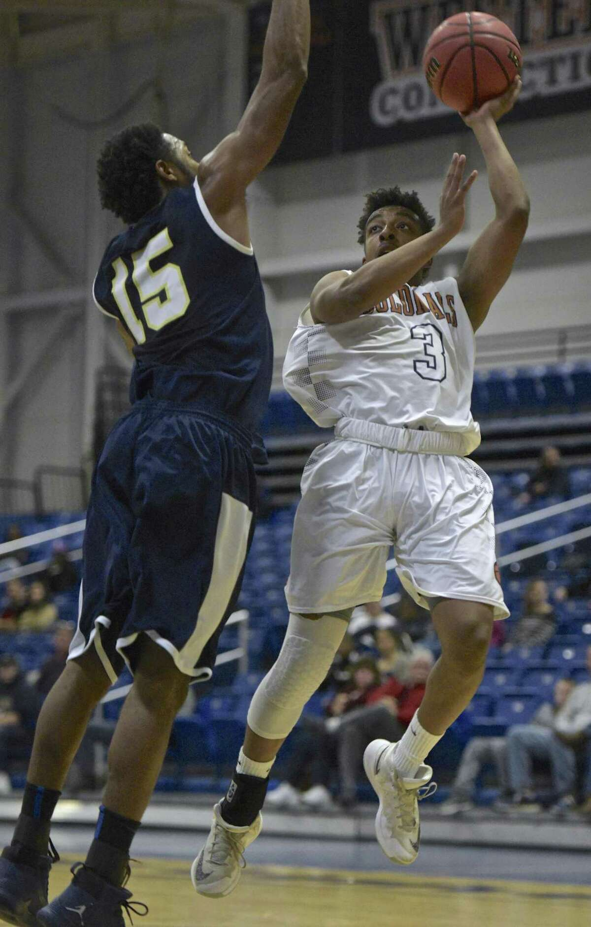 Westconn's Tyler Rowe (3) goes to shoot over Trinity's Kyle Padmore (15) in the Men's basketball game between Trinity College and Western Connecticut State University on Thursday night, November 30, 2017, at the O'Neil Center-Feldman Arena, Westside Campus of WCSU, in Danbury, Conn.