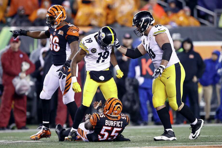 CINCINNATI, OH - DECEMBER 04:  JuJu Smith-Schuster #19 of the Pittsburgh Steelers stands over Vontaze Burfict #55 of the Cincinnati Bengals after a hit during the second half at Paul Brown Stadium on December 4, 2017 in Cincinnati, Ohio.  (Photo by Andy Lyons/Getty Images) ORG XMIT: 700070787 Photo: Andy Lyons / 2017 Getty Images