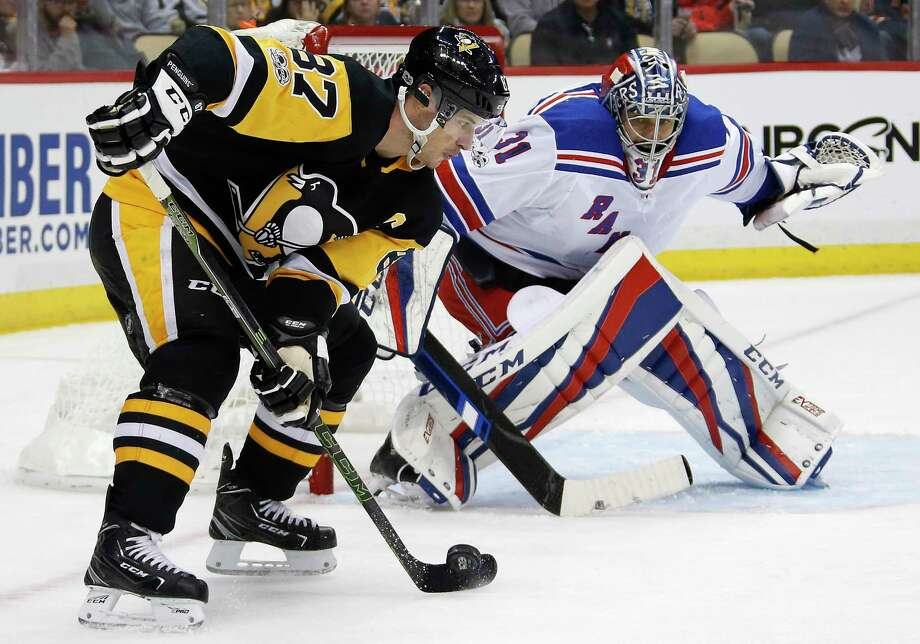 Pittsburgh Penguins' Sidney Crosby (87) works to get off a shot in front of New York Rangers goalie Ondrej Pavelec (31) during the second period of an NHL hockey game in Pittsburgh, Tuesday, Dec. 5, 2017. (AP Photo/Gene J. Puskar) ORG XMIT: PAGP111 Photo: Gene J. Puskar / Copyright 2017 The Associated Press. All rights reserved.