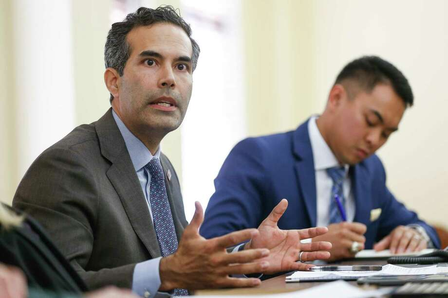 Texas Land Commissioner George P. Bush, left, talks to Fort Bend County representatives and representatives from cities in Fort Bend County during a roundtable discussion about the state of housing recovery after Hurricane Harvey at the Historic Courthouse Tuesday, Nov 28, 2017 in Richmond. ( Michael Ciaglo / Houston Chronicle) Photo: Michael Ciaglo, Houston Chronicle / Michael Ciaglo