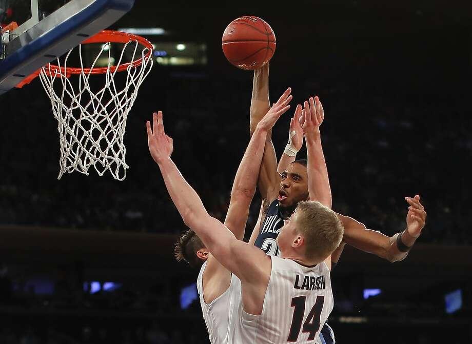 Villanova guard Mikal Bridges dunks over Gonzaga's Killian Tillie and Jacob Larsen. Photo: Julie Jacobson, Associated Press