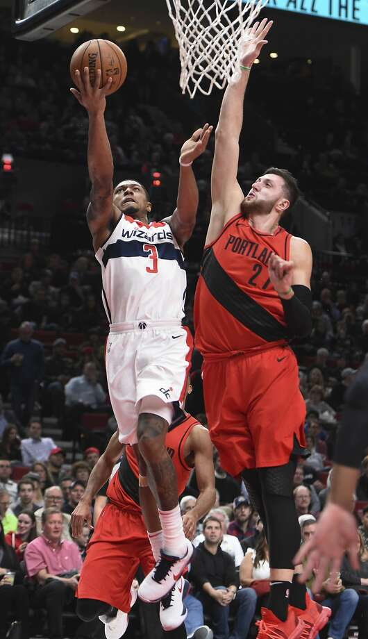 Washington Wizards guard Bradley Beal drives to the basket against Portland Trail Blazers center Jusuf Nurkic during the first half of an NBA basketball game in Portland, Ore., Tuesday, Dec. 5, 2017. (AP Photo/Steve Dykes) Photo: Steve Dykes, Associated Press