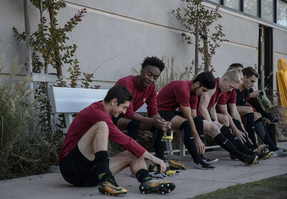 Putting on shoes L-R are seniors Drew Skundrich and Bryce Marion and other non-seniors Amir Bashti, Collin Liberty, Derek Waldeck, Eduardo Palacios Fabre on Tuesday, Dec. 5, 2017 in Stanford, CA. Photo: Paul Kuroda, Special To The Chronicle