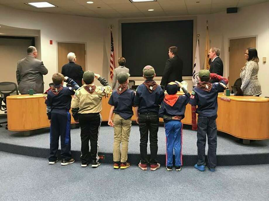 Cub Scout Pack 3758 from Plymouth Elementary leads Midland City Council in the national anthem before the Dec. 4 meeting at City Hall, 33 West Ellsworth Street. (Kate Carlson/kcarlson@mdn.net)