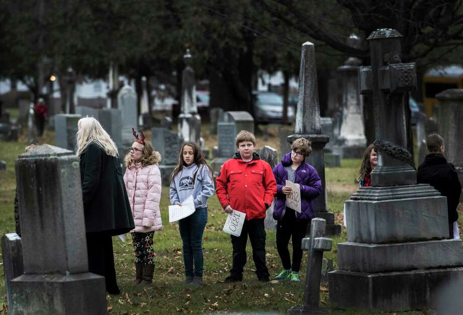 Students from Ichabod Crane School wait their chance to give a timeline of President Martin Van Buren's life during the celebration of the President's 235th birthday at the Kinderhook Cemetery Tuesday Dec 5, 2017 in Kinderhook, NY.   (Skip Dickstein/ Times Union) Photo: SKIP DICKSTEIN / 20042309A