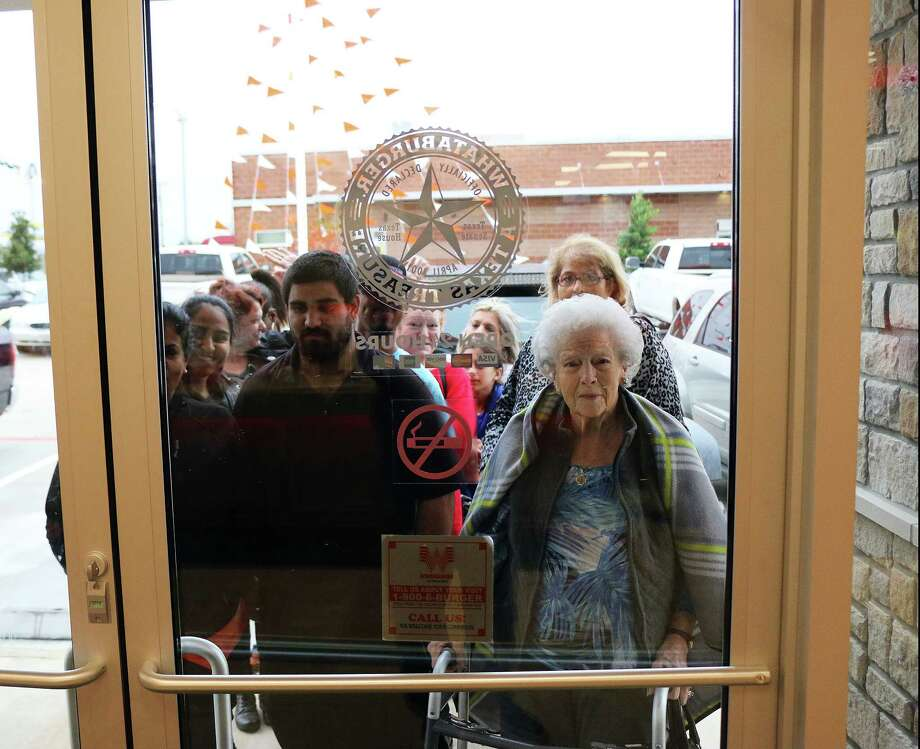 Dozens of people began lining up outside the doors of the Whataburger in Liberty, Texas, prior to its opening on Tuesday as early as 1:45 p.m. The popular eatery reopened after a fire destroyed the previous building on May 31. Photo: David Taylor