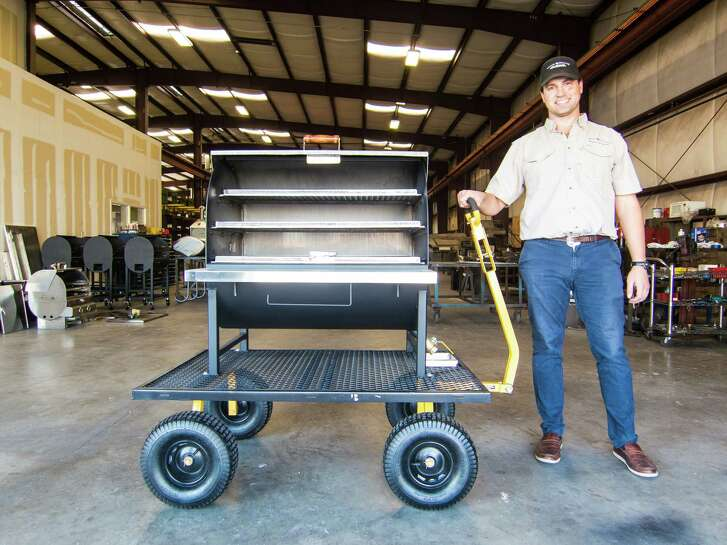 Owner Ryan Zboril with a barbecue pit under construction at Pitt's & Spitt's