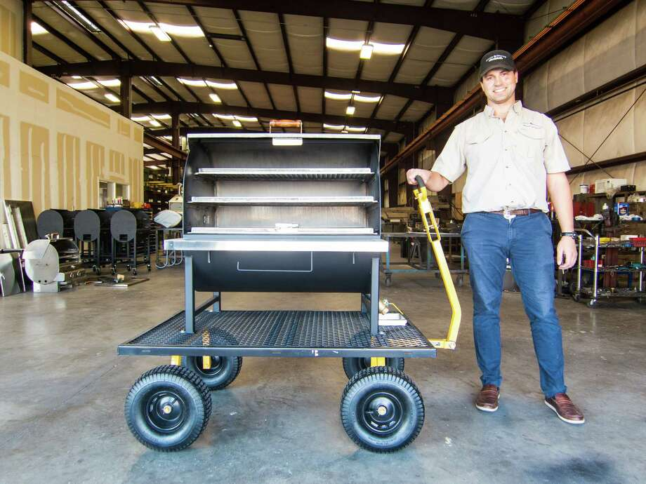 Owner Ryan Zboril with a barbecue pit under construction at Pitt's & Spitt's Photo: J.C. Reid