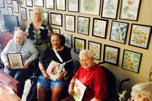 Residents at Village Crest Center for Health & Rehabilitation in New Milford participate in Colorization Club. Those who attend include, from left to right, seated, Burnetta Iveskic, Nilda Rosa, Jane Pokrywka and Janet Lynch and, standing, volunteer Pam Way.