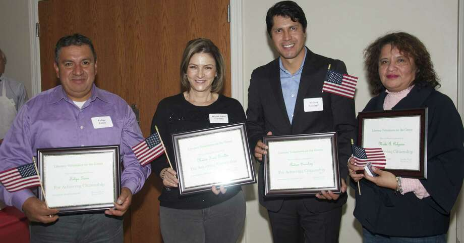 Six new United States citizens were among the students and tutors recognized at Literacy Volunteers on the Green's annual Thanksgiving student and tutor recognition celebration held at St. John's Episcopal Church hall in New Milford. Four students are shown above, from left to right, Felipe Ginin, Maria Irene Giraldo, Andres Sanchez and Marta Pulgarin. Photo: Contributed Photo / Contributed Photo / The News-Times Contributed