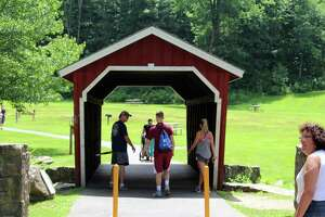 The covered bridge at Kent Falls in Kent, on July 28.