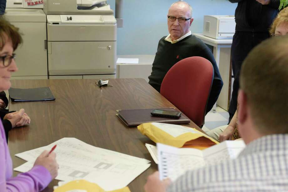 Troy Councilman Mark McGrath watches as the final three absentee ballots cast in the Rensselaer County election for 2017 are opened at the Rensselaer County Board of Elections on Wednesday, Dec. 6, 2017, in Troy, N.Y.  The three ballots would determine the outcome of the city's 2nd Council District race, which McGrath won.    (Paul Buckowski / Times Union) Photo: PAUL BUCKOWSKI, Albany Times Union / 20042327A