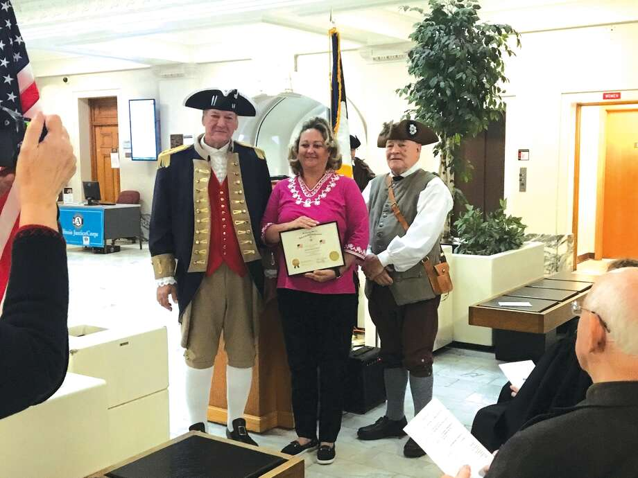 Jennifer Sparks of Hamel Township receives a certificate of recognition from members of the George Rogers Clark Chapter, Illinois Society, Sons of the American Revolution on Nov. 30 at the SAR Annual Flag Award Ceremony, which was conducted in the Madison County Courthouse. Photo: Bill Tucker • Btucker@edwpub.net
