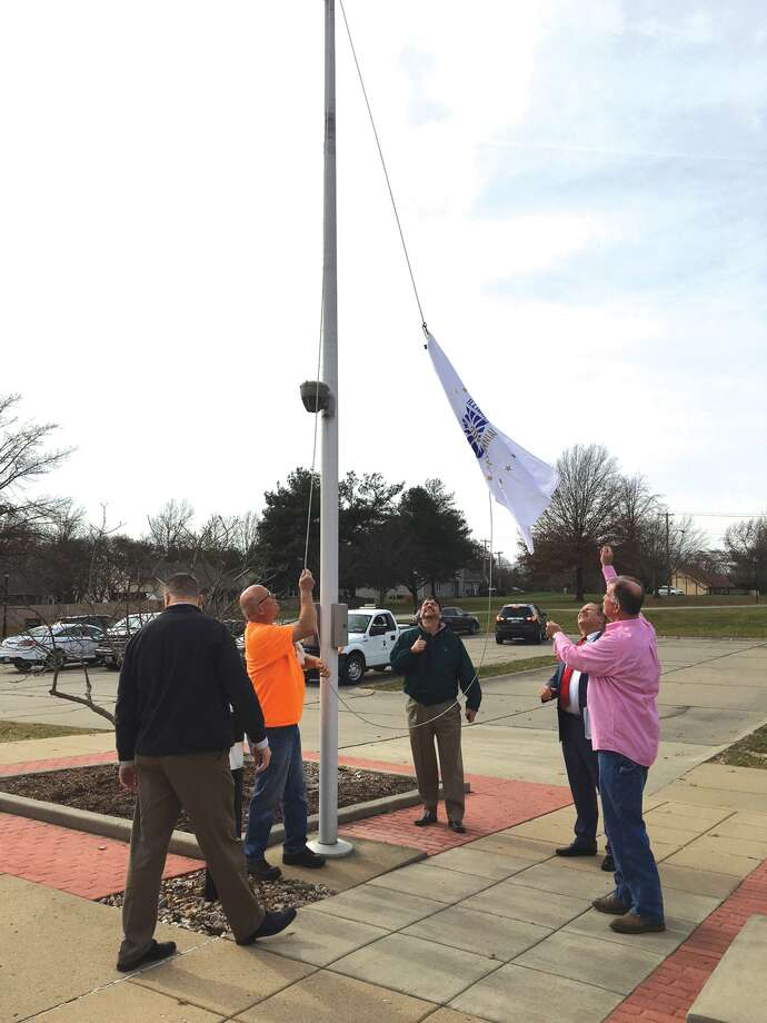 Village of Glen Carbon officials raised the official Illinois Bicentennial Flag at Village Hall on Monday. Illinois became the 21st state on Dec. 3, 1818. Glen Carbon Mayor Rob Jackstadt read a proclamation at the event recognizing Illinois' year-long bicentennial celebration. Photo: John Sommerhof • Jsommerhof@edwpub.net