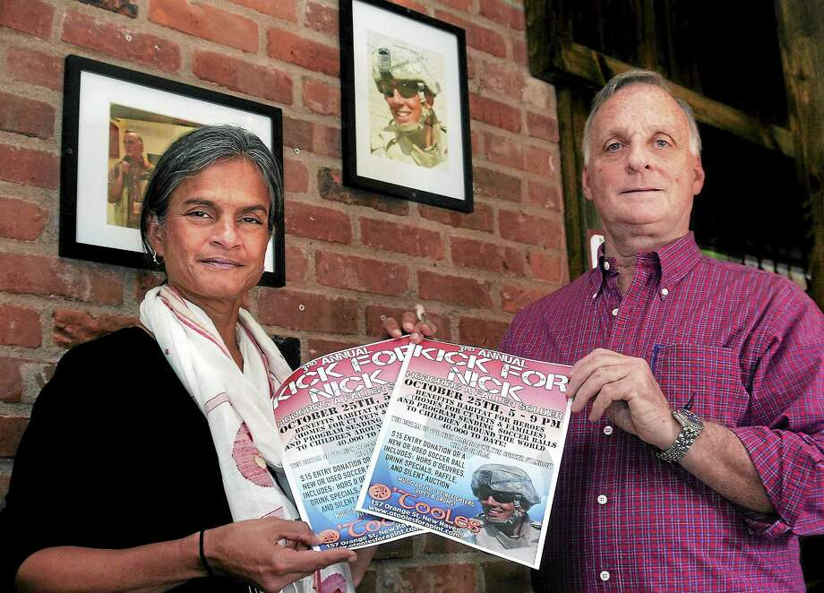Bill and Shalini Madaras, who's son Nick Madaras was killed in Iraq on September 3, 2006, would be eligible for a property tax exemption for Gold Star families under a recently enacted state law. Photo: Peter Casolino / New Haven Register