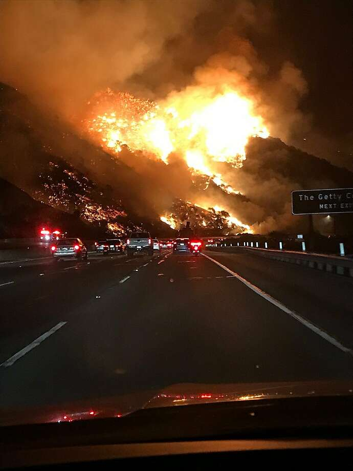 A view of the Skirball Fire from southbound 405. The fire is tearing through Bel-Air and forcing mandatory evacuations in the area. Photo: Melissa Castro