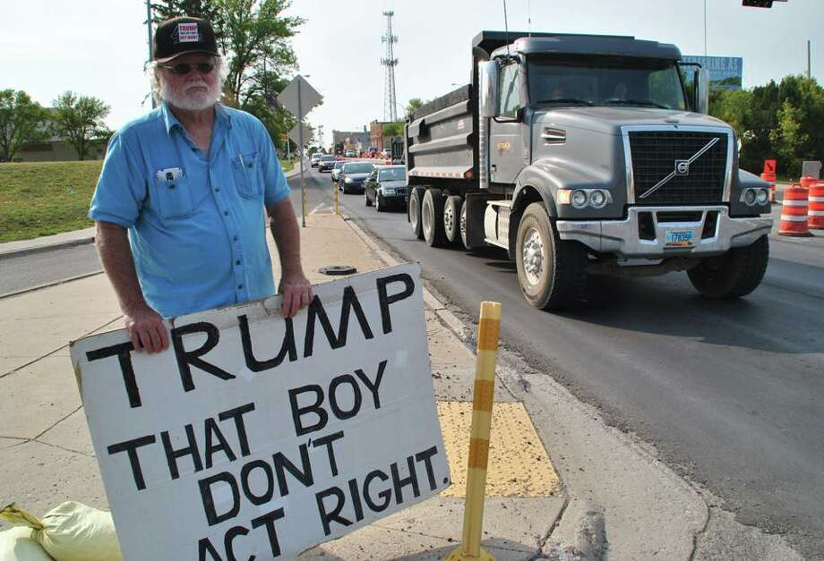 The last thing Gale McCray, 75, of Fort Worth, expected was for his simple anti-Trump sign to become one of the most recognizable images criticizing the commander-in-chief this year. Photo: Gale McCray