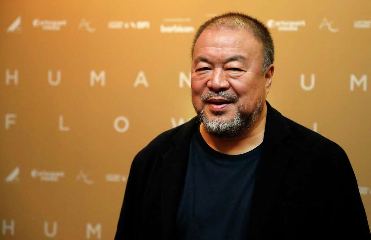Chinese artist Ai Weiwei arrives for the UK Premiere of Human Flow in London, Monday, Dec. 4, 2017. (AP Photo/Frank Augstein)