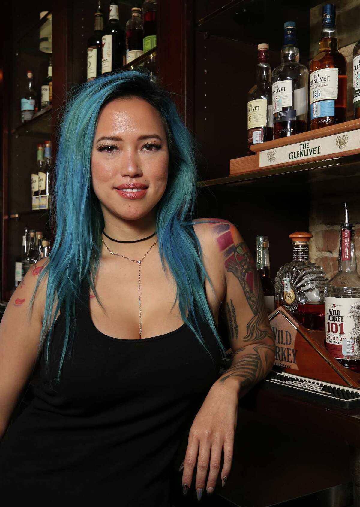 Shay McElroy's Irish Pub bartender Jeanette Do poses for a photograph Tuesday, Nov. 28, 2017, in Houston. ( Godofredo A. Vasquez / Houston Chronicle )