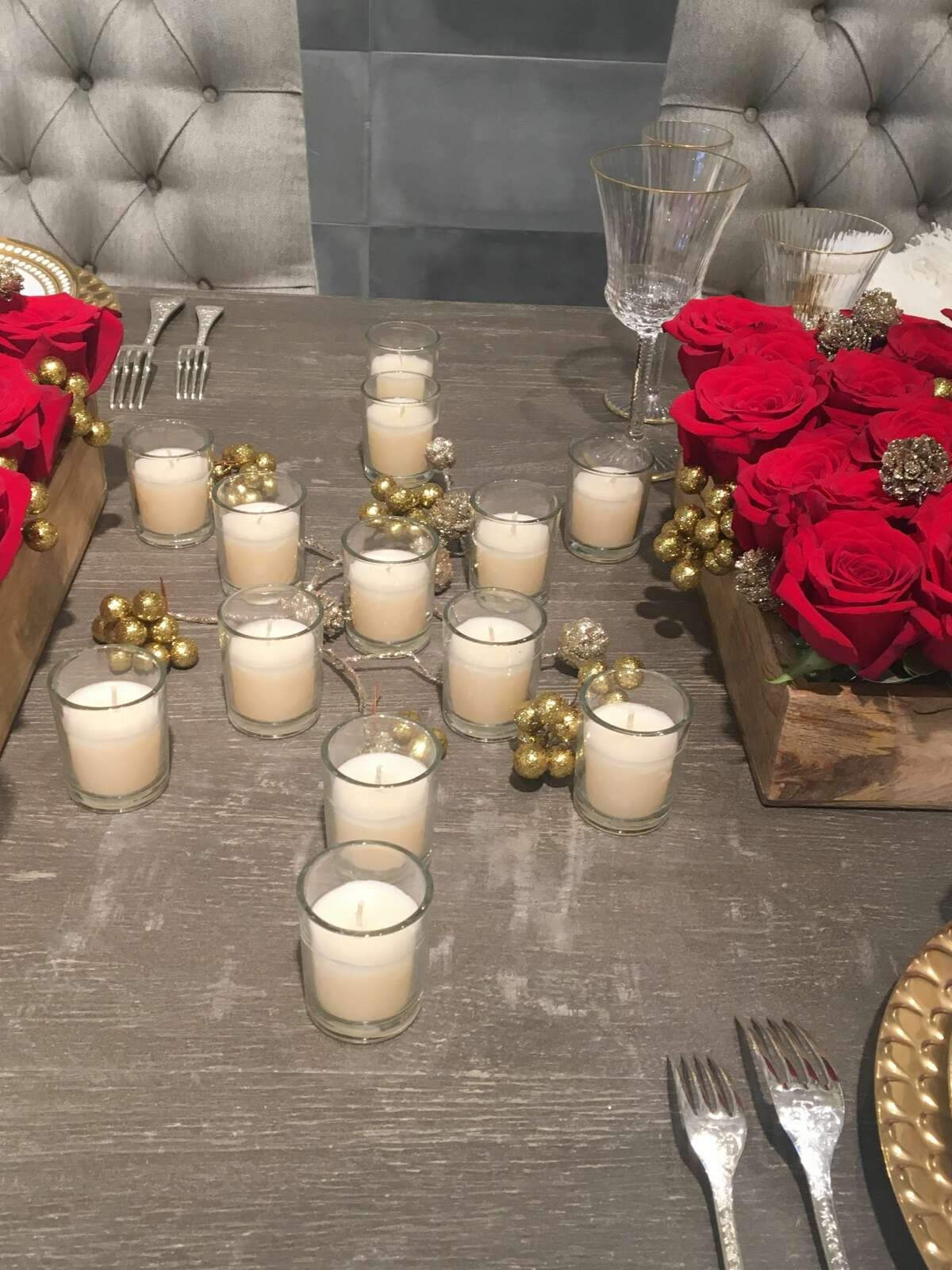 Simple votive candles are laid in the shape of a snowflake.