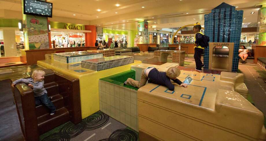 Young kids play at The Little Galleria play area in The Galleria mall on Thursday, Nov. 30, 2017, in Houston. The play area was designed as a miniature of The Galleria mall. ( Yi-Chin Lee / Houston Chronicle ) Photo: Yi-Chin Lee, Houston Chronicle / © 2017  Houston Chronicle