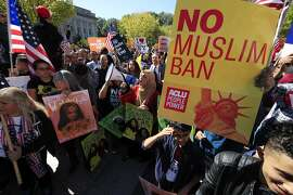 FILE - In this Oct. 18, 2017, file photo, protesters gather at a rally in Washington. The Supreme Court is allowing the Trump administration to fully enforce a ban on travel to the United States by residents of six mostly Muslim countries. The justices say in an order on Dec. 4, that the policy can take full effect even as legal challenges against it make their way through the courts. (AP Photo/Manuel Balce Ceneta, File)