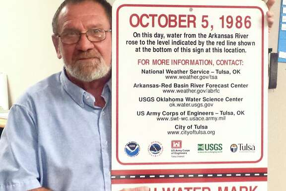 A sign that once stood near new, upscale neighborhoods on the Arkansas River in Tulsa, Oklahoma, warning of catastrophic flooding, now sits in Chief Hydrologist Bill Robinson's city office after a developer complained to the mayor.