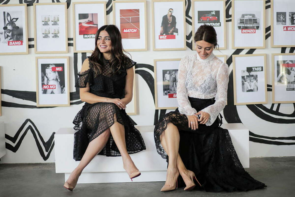 Sister interior design duo Sarah, left, and Saba Jawda model monochromatic looks from baanou at their holiday pop-up warehouse store.