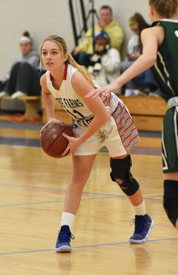Greens Farms Academy guard Bella Litt, a resident of Darien, looks to make a pass during Saturday's game against Chase Collegiate at the Westover Tournament. Photo: Contributed Photo / Darien News contributed
