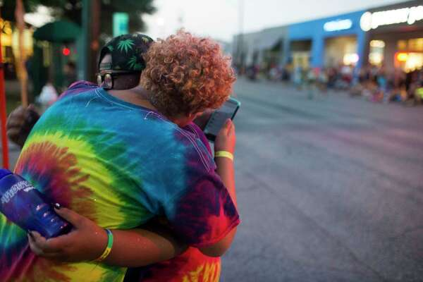 Adam Snow hugs his then boyfriend, AJ Sanchez, during Pride.
