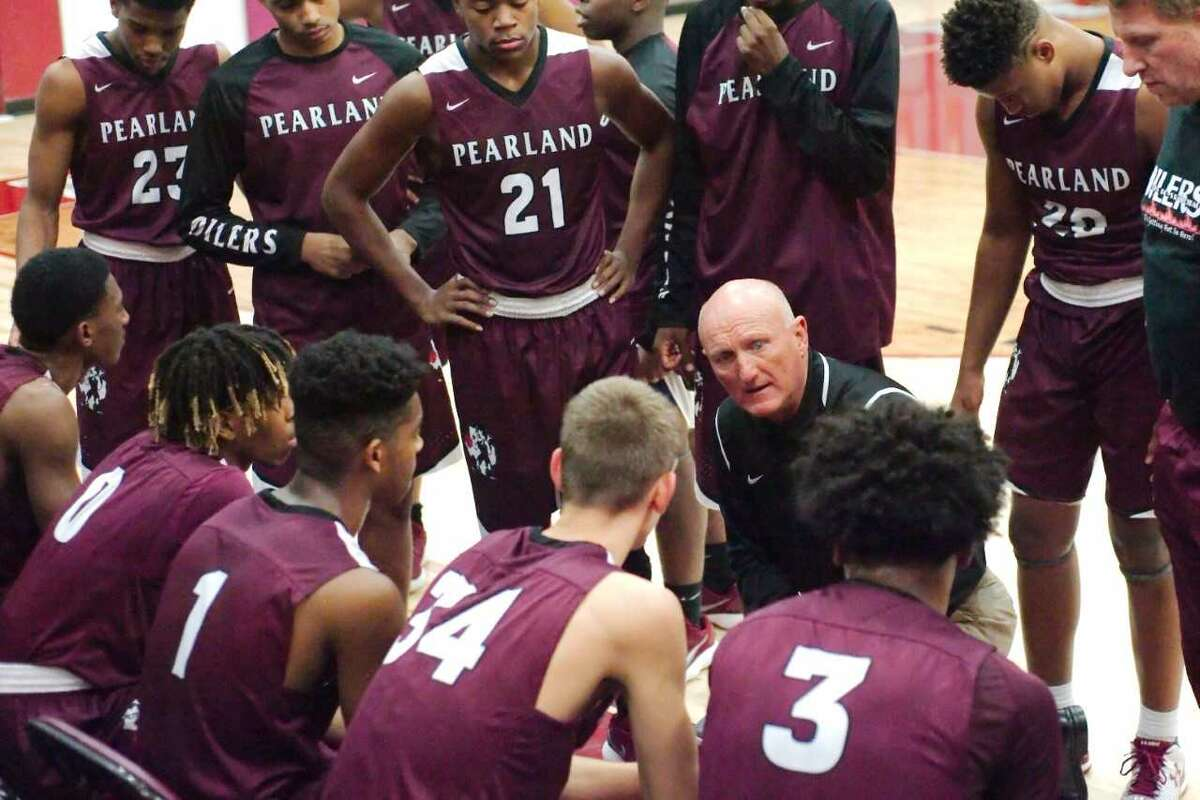 Pearland head coach Steve Buckelew talks to his team during a timeout in Tuesday's 59-50 win over Clear Creek in a non-district boys' basketball game.