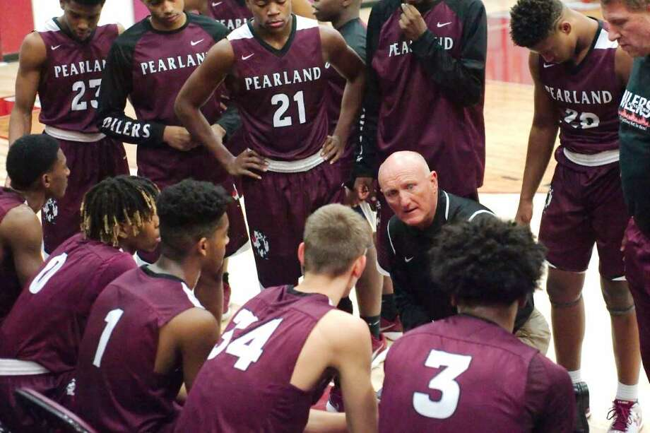 Pearland head coach Steve Buckelew talks to his team during a timeout in Tuesday's 59-50 win over Clear Creek in a non-district boys' basketball game. Photo: Kirk Sides