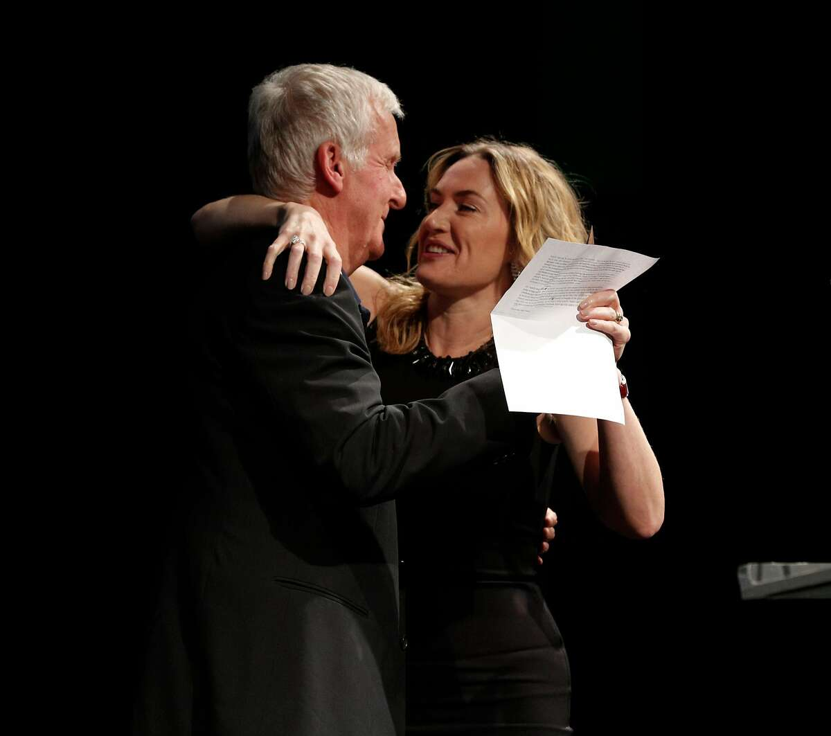 Kate Winslet hugs James Cameron as he presents her with the Peter J. Owens Award for Acting during the SFFILM Awards Night at the Palace of Fine Arts Exhibition Center in San Francisco, Calif., on Tuesday, December 5, 2017. Kathryn Bigelow was awarded the Irving M. Levin Award for Film Direction, Kate Winslet the Peter J. Owens Award for Acting, and Emily V. Gordon and Kumail Nanjiani the Kanbar Award for Storytelling.