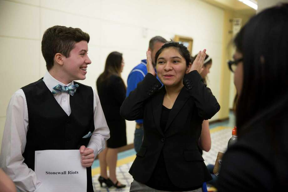 Jackson Farner, 16, laughs with his teammates after a presentation on the Stonewall Riots at a regional history fair held at Texas A&M San Antonio. Photo: Carolyn Van Houten, San Antonio Express-News / 2017 San Antonio Express-News